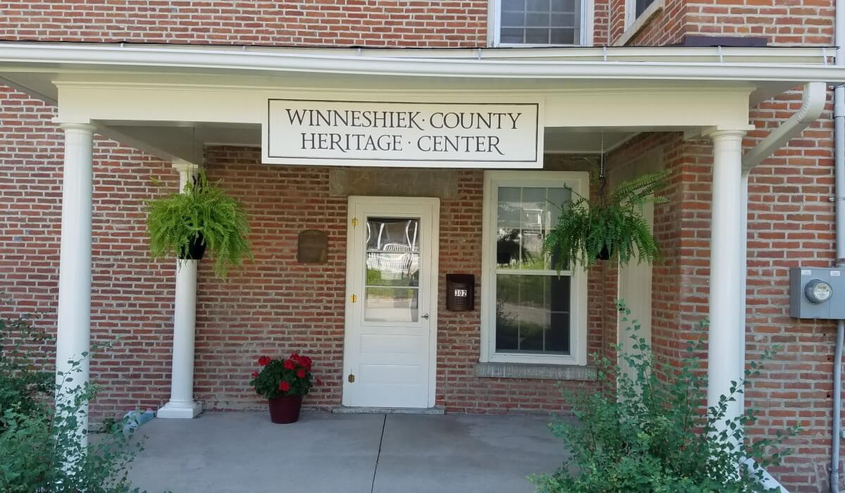 Post Photo for New signage and continuing exterior restoration efforts are visible at the local Historical Society's Winneshiek County Heritage Center