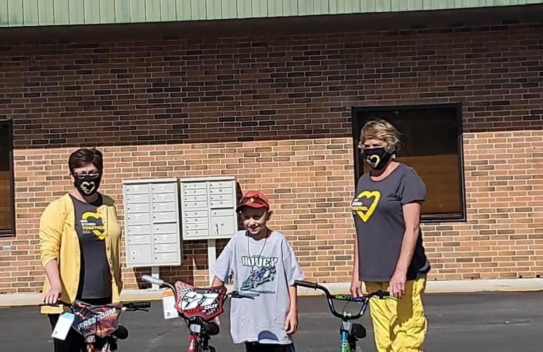 Post Photo for Boy donates 3 new bikes